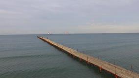 Aerial view: sea and sunrise. Bridge on sea. Amazing view stock footage