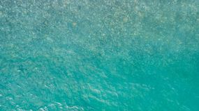 Aerial view of sea surface. Top view of transparent turquoise ocean water surface. royalty free stock photos