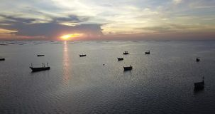 Aerial view of sea surface traveling around with beautiful sunset showing boats in water, drone shot, videography. Aerial view of sea surface traveling around stock footage