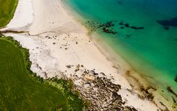 Aerial view. Sea water and sandy shoreline. Aerial view. Blue sea water and sand beach shore. Summertime royalty free stock images