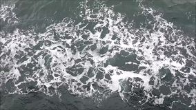 Aerial view of sea waves. View from the deck of the ship on the sea waves and breeze stock video footage