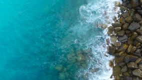 Aerial view on the sea waves and rocks, the Mediterranean sea.