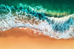 Aerial view of sea waves and sandy beach royalty free stock images