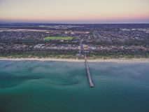 Aerial view of Seaford suburb in Melbourne and long wooden pier. At dusk stock images
