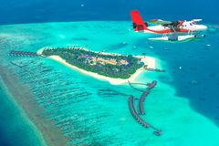 Aerial view of a seaplane approaching island in the Maldives Royalty Free Stock Images