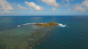 Aerial view Seascape with tropical island, beach, rocks and waves. Catanduanes, Philippines. Aerial view:Tropical island with beach, mountains and the stock video