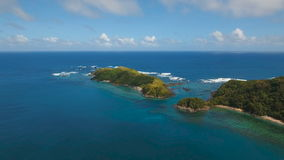 Aerial view Seascape with tropical island, beach, rocks and waves. Catanduanes, Philippines. stock video