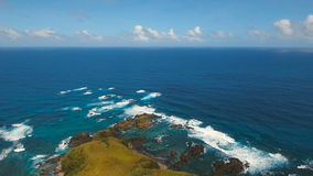 Aerial view Seascape with tropical island, beach, rocks and waves. Catanduanes, Philippines. stock footage