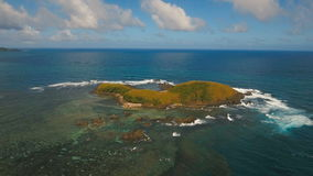 Aerial view Seascape with tropical island, beach, rocks and waves. Catanduanes, Philippines. Aerial view:Tropical island with beach, mountains and the stock video footage