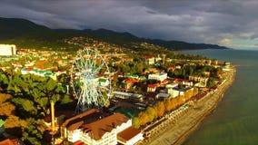 Aerial view on seashore resort area. With big wheel, Black Sea, Russia stock video footage