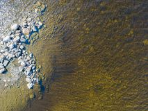 Aerial view of seashore with stone beach, lagoons and coral reefs. Coastline with sand, stone and water. Tropical landscape. Aeria. L photography. Birdseye. Sea stock photos