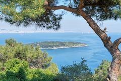 Aerial view of Sedef Island Mother of Pearl Island framed by green trees from Buyukada island, Istanbul, Turkey. Aerial view of Sedef Island Mother of Pearl Stock Photography