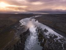 Aerial view of Selfoss waterfall in Iceland. Flying over Selfoss waterfall in North Iceland during a cloudy, colorful sunrise Royalty Free Stock Photo