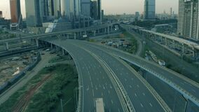 Aerial view of a semi-trailer truck driving on empty highway in urban environment