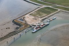 Aerial view service harbor at Dutch island Ameland. In Wadden sea stock photo