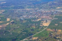 Aerial view of settlement. Aerial view of green fields and little town stock image