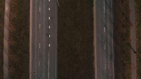 Aerial view of several parallel roads with traffic and people walking - Cinematic drone shot flying over road in Riga stock video