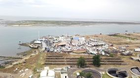 Aerial view of sewage treatment plant and shipyard in Olhao, Portugal