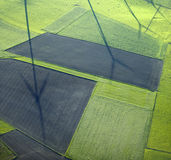Aerial View : Shadows of windturbines in fields. And meadows Stock Image