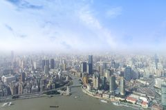 Aerial view of Shanghai city skyline and modern skyscraper and H. Istorical architecture on the bund of Shanghai in misty sky pollution haze, in Shanghai, China Stock Image