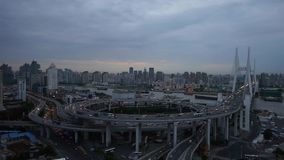 Aerial view of shanghai nanpu overpass traffic interchange,time lapse. Aerial freeway busy city rush hour heavy traffic jam highway Shanghai china,nanpu stock video footage