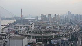 Aerial view of shanghai nanpu overpass traffic,serious pollution haze. Aerial freeway busy city rush hour heavy traffic jam highway Shanghai china,nanpu stock footage