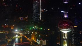 Aerial view of shanghai Oriental Pearl Tower at night,urban traffic & shipping. Elevated view of Oriental Pearl Tower rooftop crown  with river at night in stock video footage