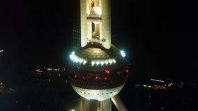 Aerial view of shanghai Oriental Pearl Tower with river at night,china. stock video footage