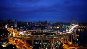 Aerial view of shanghai overpass traffic at night,urban blue skyline,timelapse. Aerial freeway busy city rush hour heavy traffic jam highway Shanghai at night stock footage