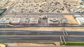 Aerial view of Sheikh Zayed highway road timelapse in Dubai with traffic and a metro station. Aerial top view of Sheikh Zayed highway road timelapse in Dubai stock footage