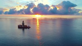 Aerial view of ship at sunrise stock video