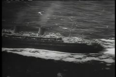 Aerial view of ship traveling across the ocean stock video footage