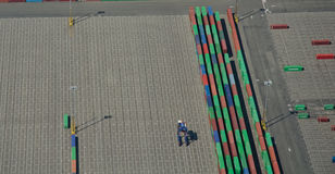 Aerial View of Shipping Port. Containers lined up to be loaded onto freight tanker ship at port Stock Image