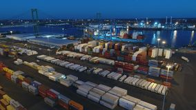 Aerial view shipping port at night stock footage