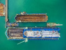 Aerial view shipyard have crane machine and container ship in gr Stock Image