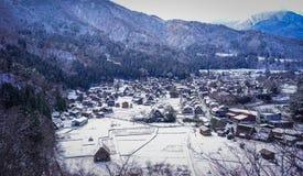 Shirakawago Historic Village in Gifu, Japan. Aerial view of Shirakawago Village at winter in Gifu, Japan. Shirakawago has over 100 unique gossho-zukuri houses Royalty Free Stock Images
