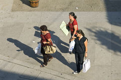 Aerial view of shopping women, Portugal. Portugal, Viana do Castelo, in the small town of Ponte de Lima walk to jeer three women with their purchased items Royalty Free Stock Image