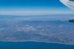 Aerial view of the shore of Los Angeles County. In an airplane window seat Royalty Free Stock Photography