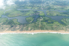 Aerial view of the shores of Cotonou, Benin. Aerial view of the Atlantic Ocean coastline along the shores of Cotonou, Benin stock photos