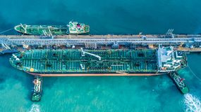 Aerial view shot of crude oil tanker ship anchored at the oil te. Rminal at port Royalty Free Stock Photos