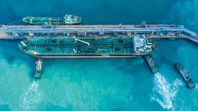 Aerial view shot of crude oil tanker ship anchored at the oil te. Rminal at port Stock Images