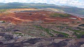 Aerial view shot for Mining dump trucks working in Lignite coalmine lampang thailand. Video Aerial view shot for Mining dump trucks working in Lignite coalmine stock video