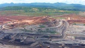 Aerial view shot for Mining dump trucks working in Lignite coalmine lampang thailand stock video