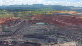 Aerial view shot for Mining dump trucks working in Lignite coalmine lampang thailand stock footage