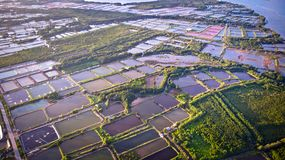 Aerial view of shrimp farm and air purifier in Thailand. Continuous growing aquaculture business is exported to the international royalty free stock photography