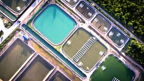 Aerial view of shrimp farm and air purifier in Thailand. Continuous growing aquaculture business is exported to the international stock photography