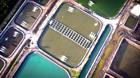 Aerial view of shrimp farm and air purifier in Thailand. Continuous growing aquaculture business is exported to the international. Market royalty free stock images