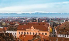 Aerial view of Sibiu and the mountains. Aerial view of Sibiu in Transylvania, Romania and the Carpathian mountains Royalty Free Stock Photography