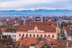 Aerial view of Sibiu and the mountains. Aerial view of Sibiu in Transylvania, Romania and the Carpathian mountains Royalty Free Stock Images