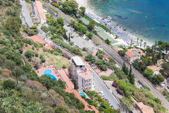 Aerial view Sicilian coast of Taormina with hotels and beach royalty free stock images